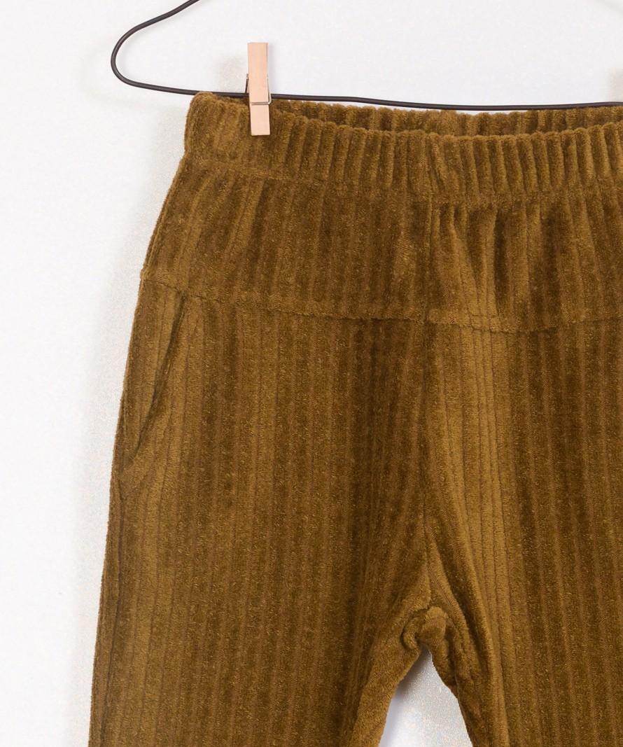 Calças dupla face, cintura subida e bolsos laterais