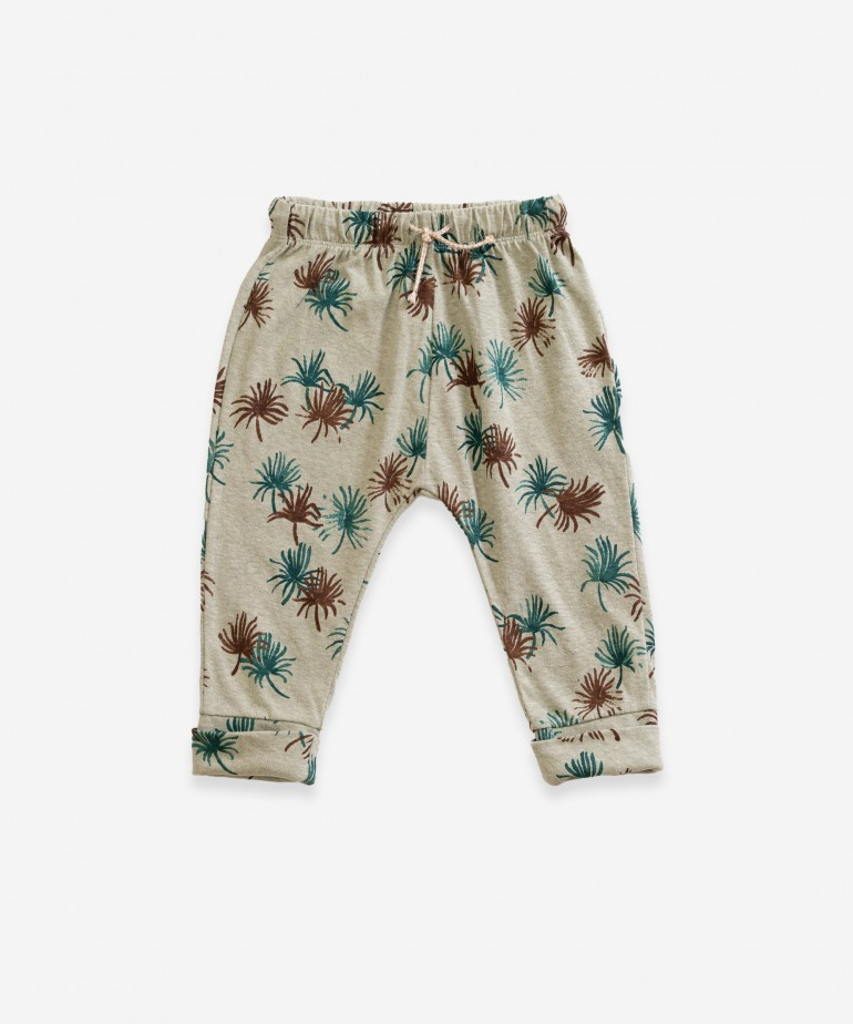 Trousers with palmtree print