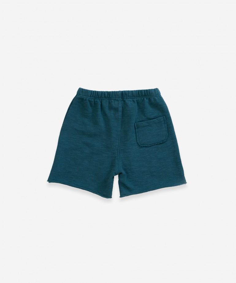 Pantalón corto con bolsillo