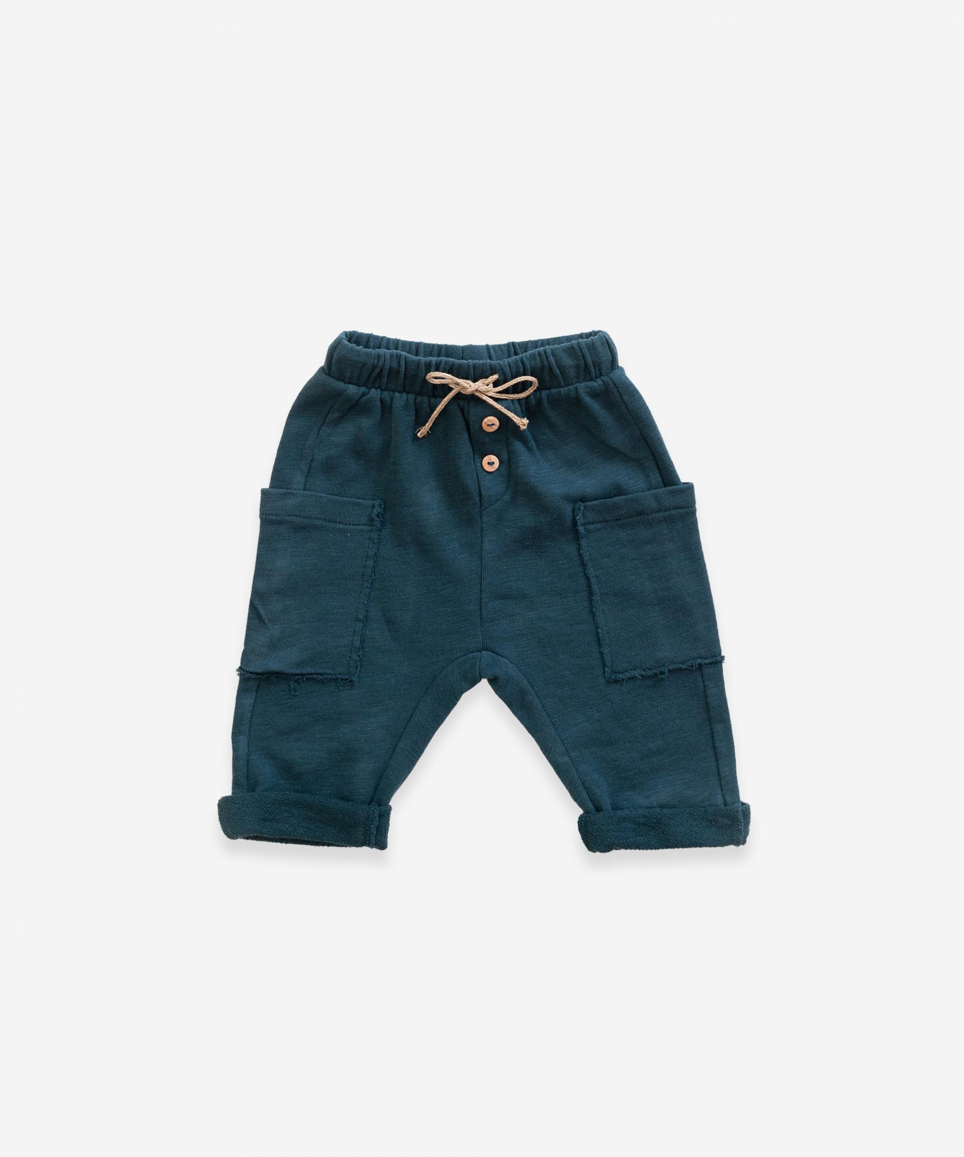 Pantaloni con tasche laterali in cotone biologico| Weaving