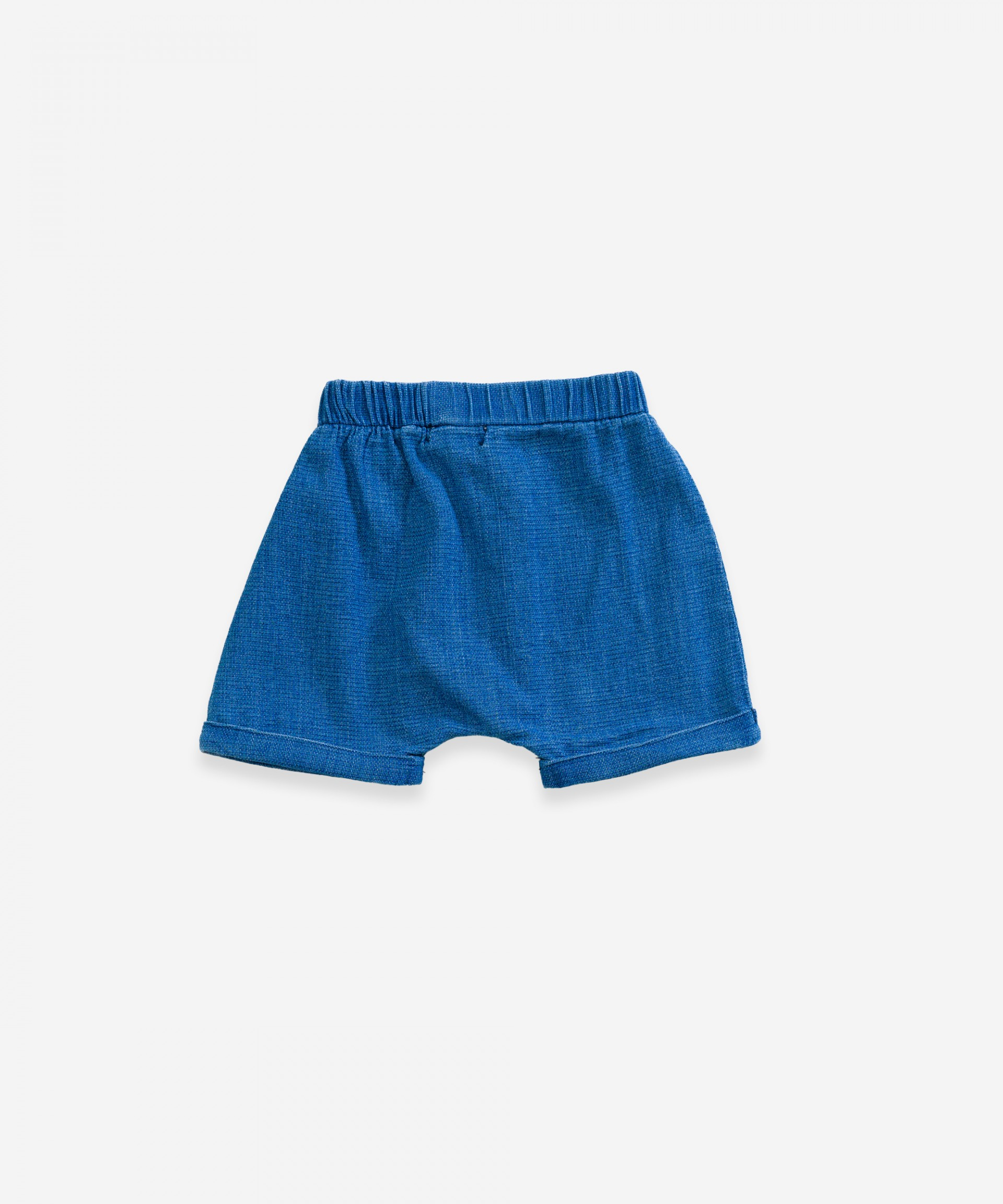 Denim shorts with buttons | Weaving