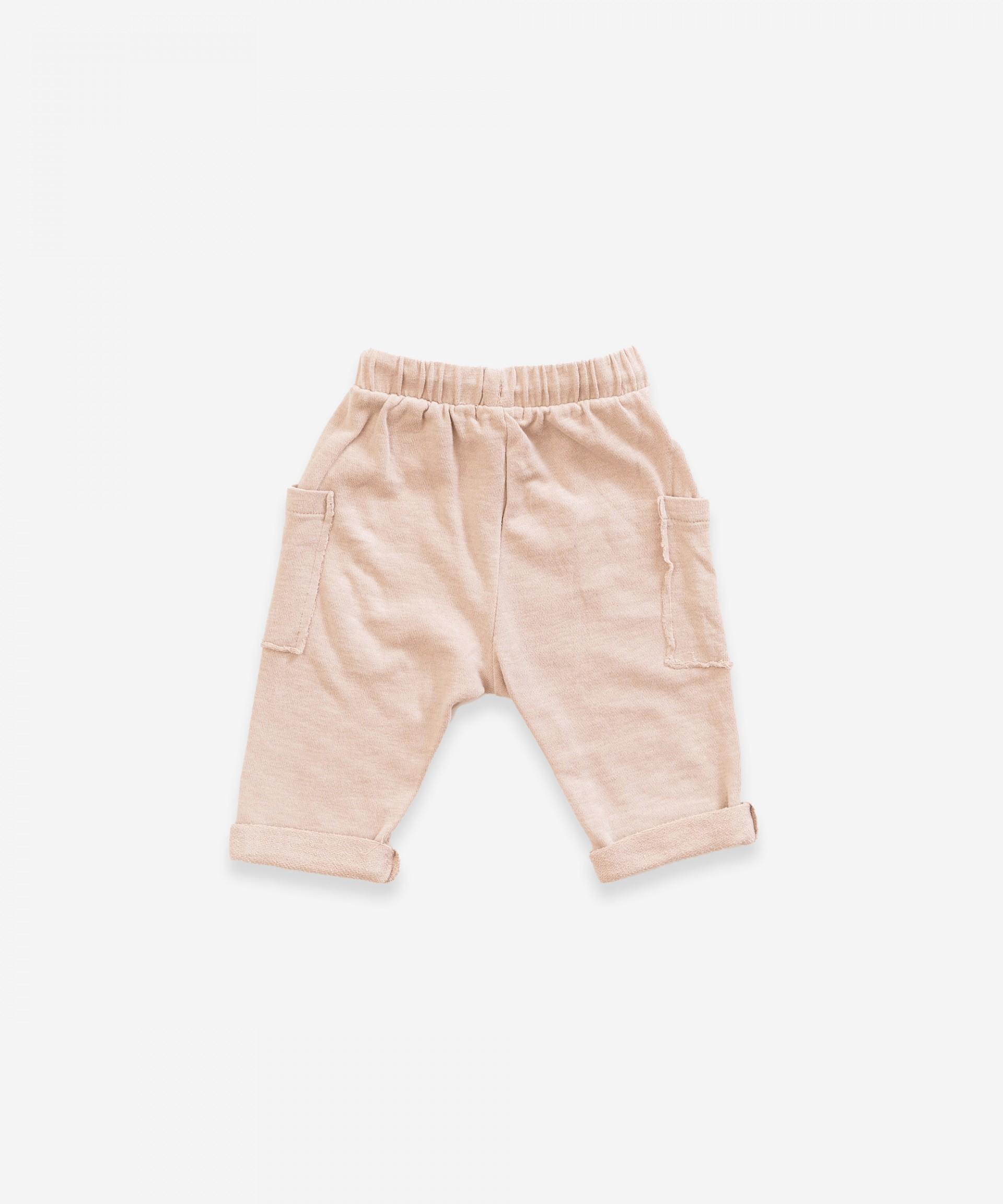 Pantalón de algodón orgánico con bolsillos laterales| Weaving