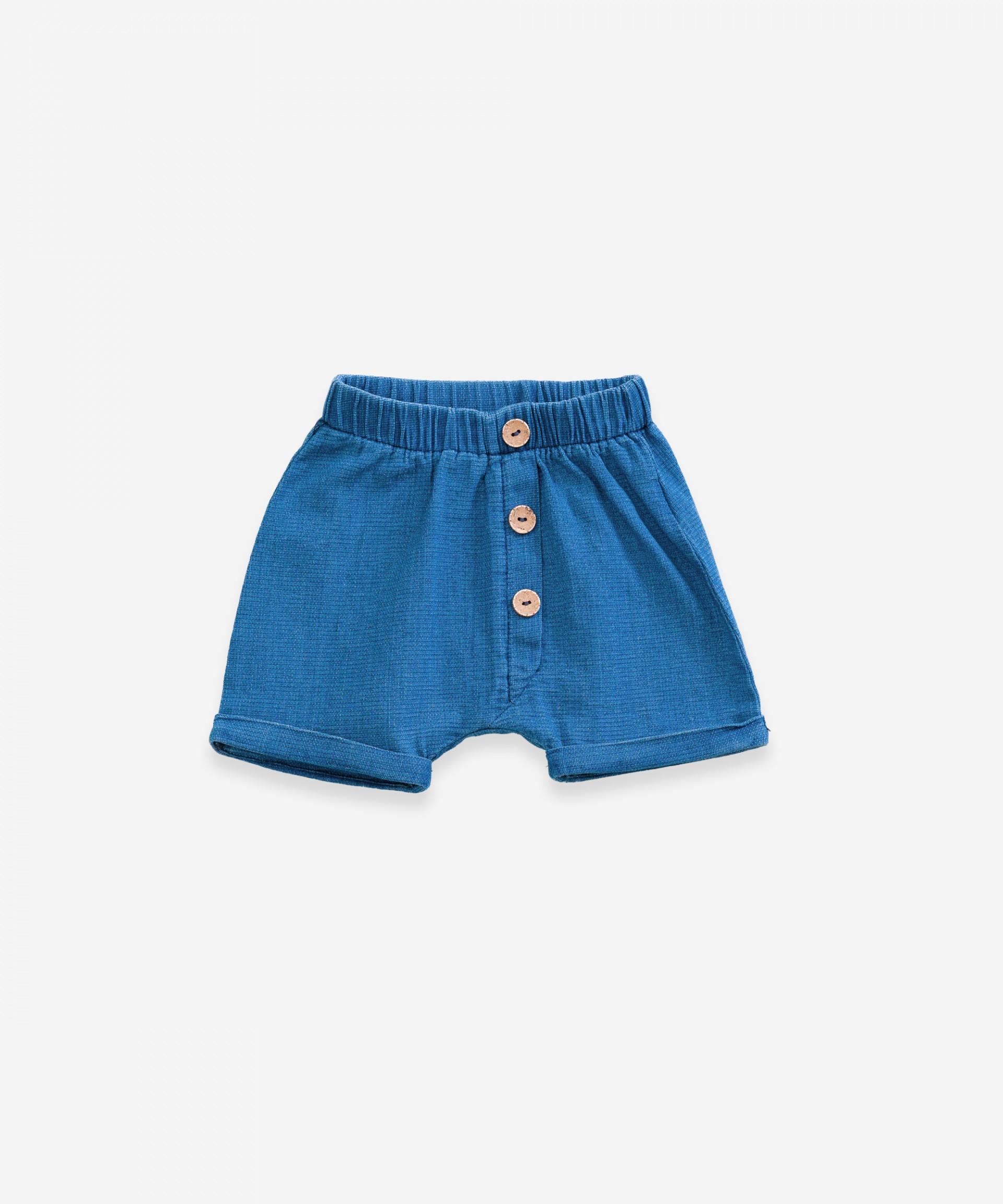 Pantalón corto vaquero con botones| Weaving