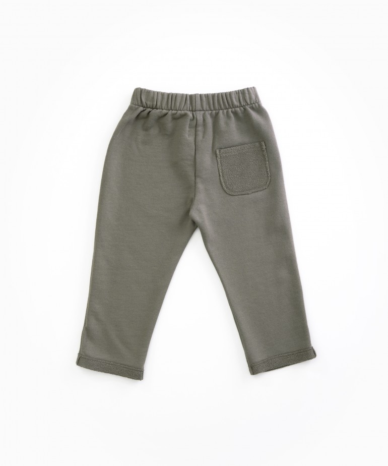 Trousers with rear pocket