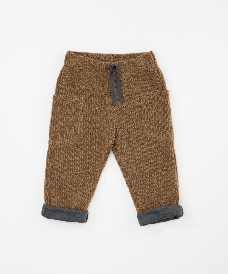 Trousers with recycled fibres