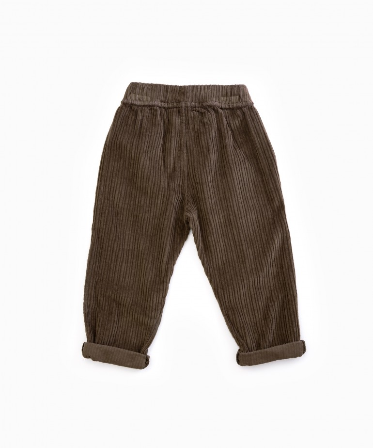 Corduroy trousers with decorative buttons