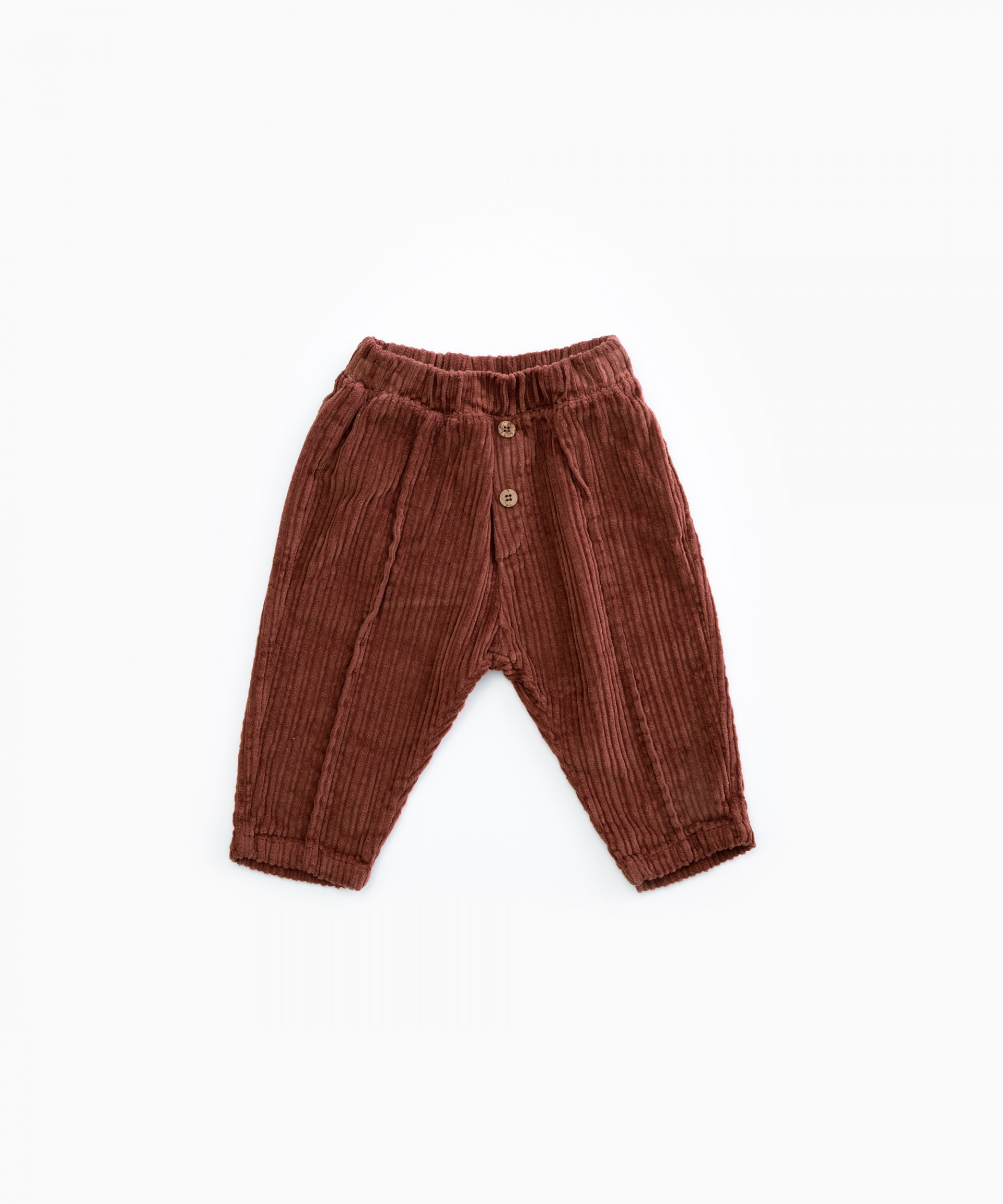 Corduroy trousers with decorative buttons | Woodwork