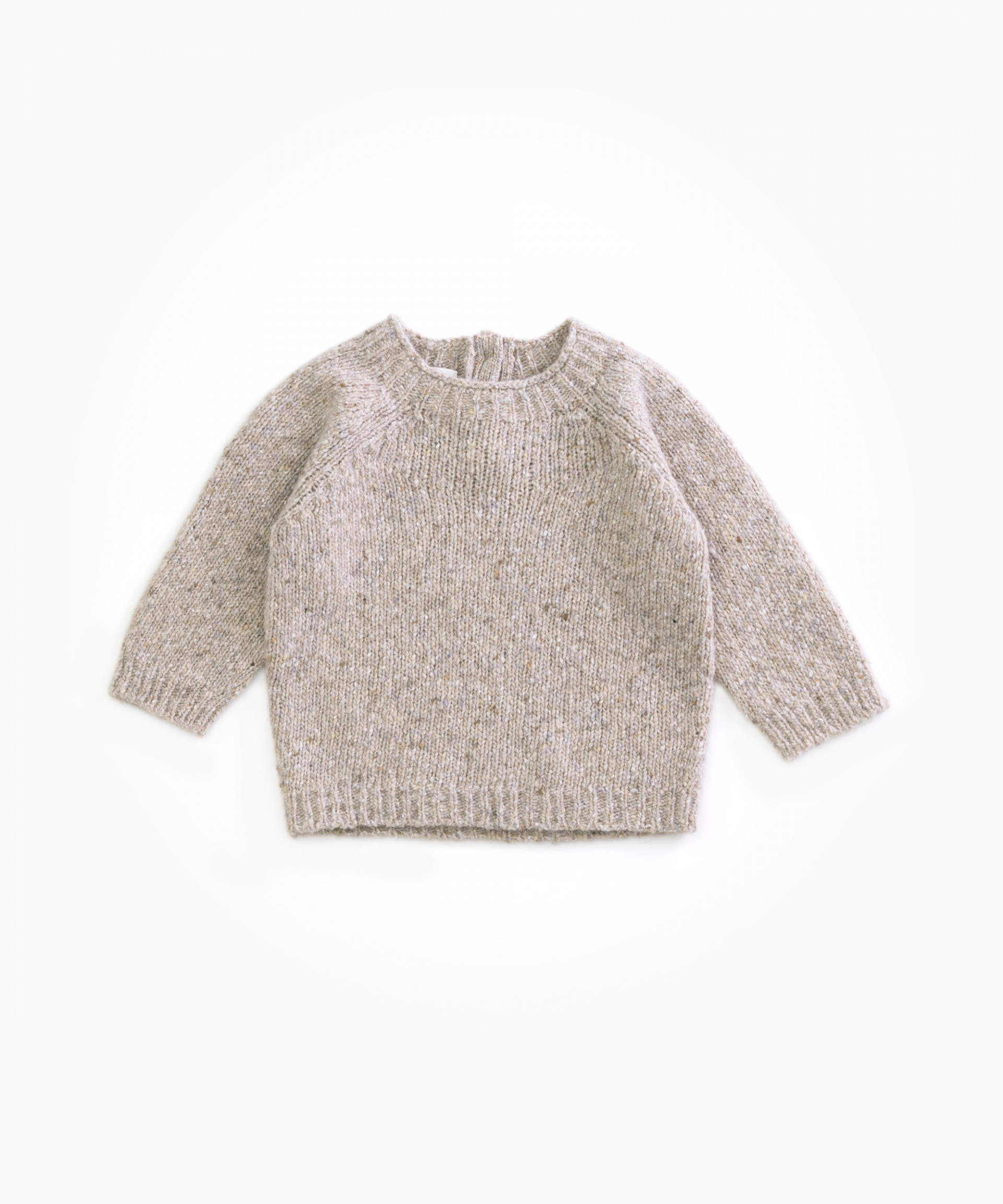 knitted sweater with coconut buttons| Woodwork