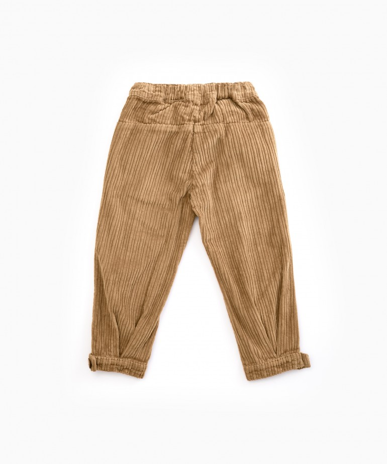 Corduroy trousers with hem button