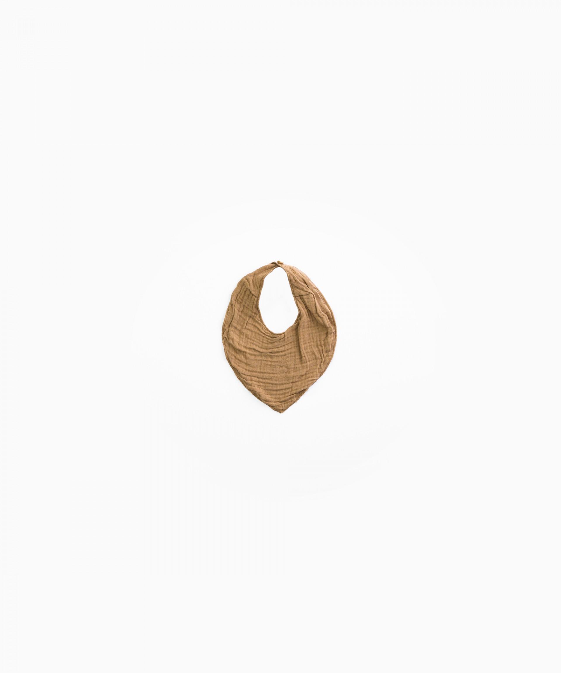 Bib with button fastening | Woodwork