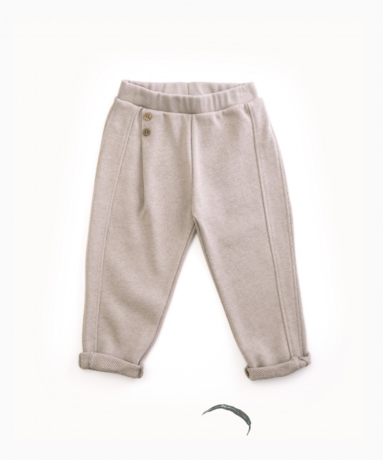 Trousers with decorative buttons