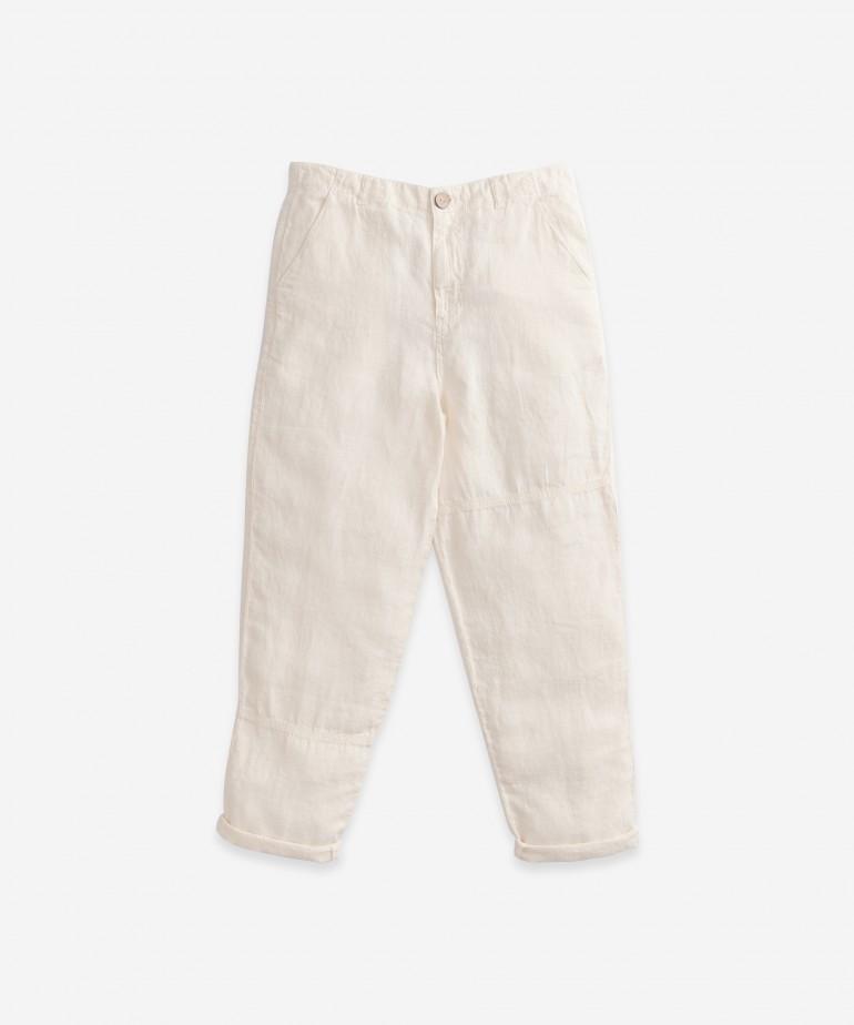 Pantaloni di lino con bottone in cocco