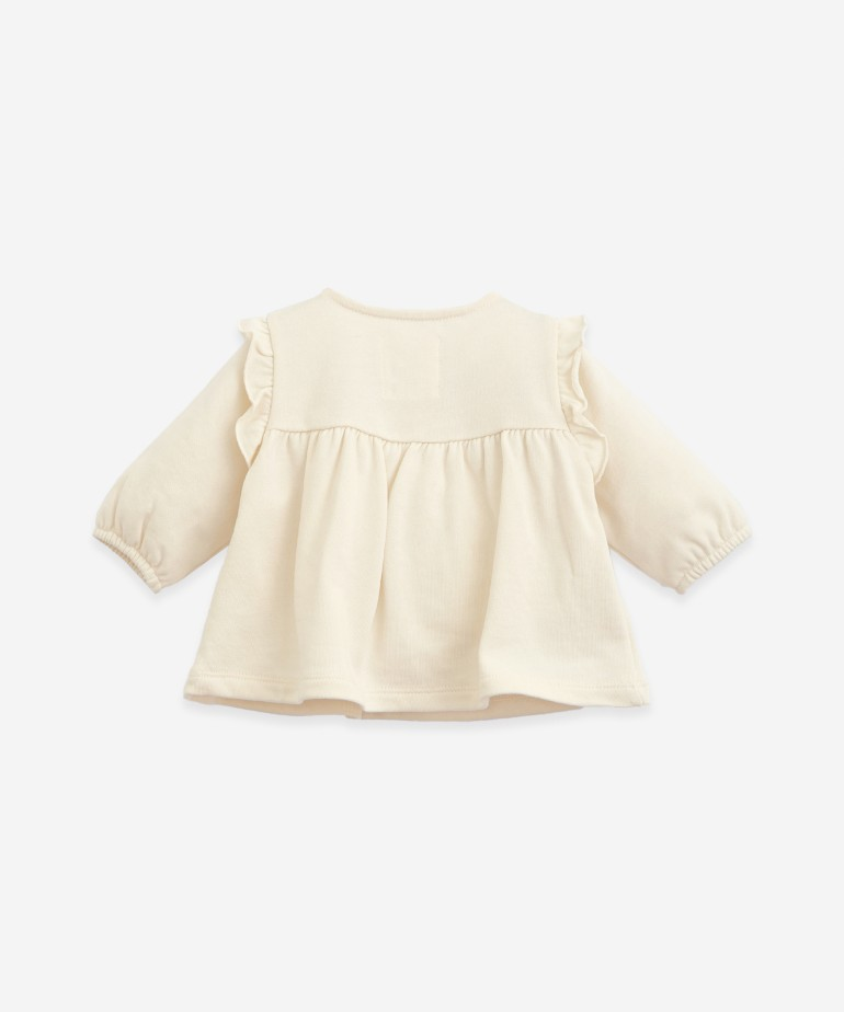 Jersey in organic cotton with a frill