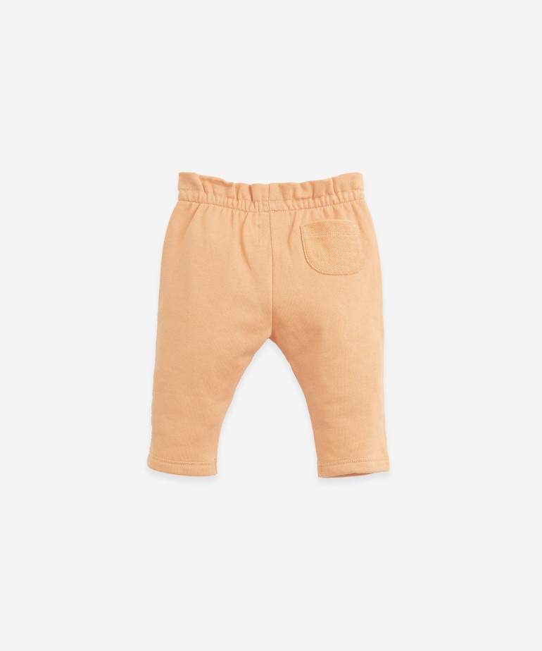 Trousers in organic cotton with a pocket