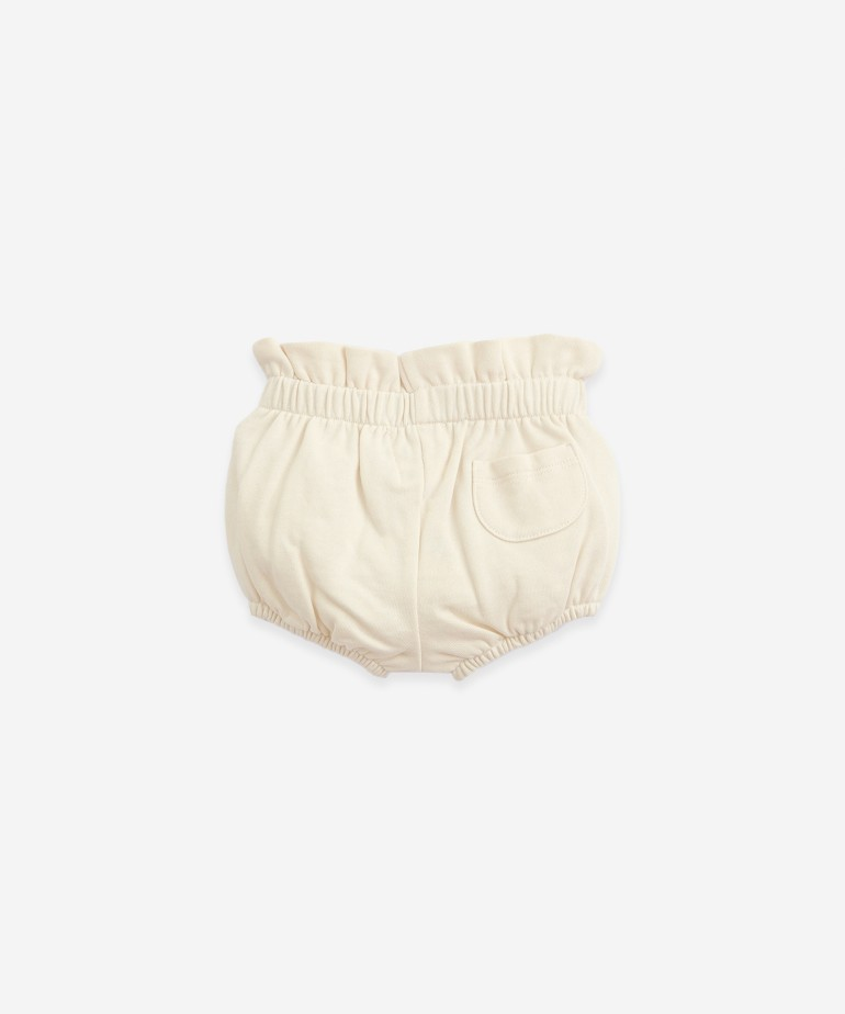 Shorts in organic cotton with a pocket