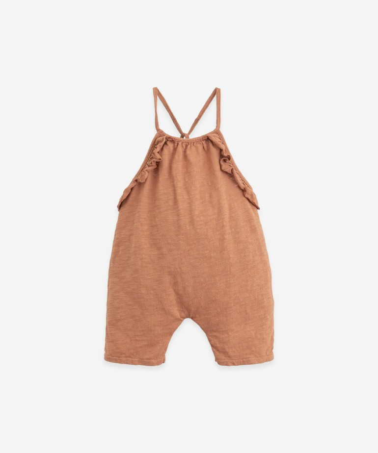 Jersey stitch jumpsuit with detail on the straps