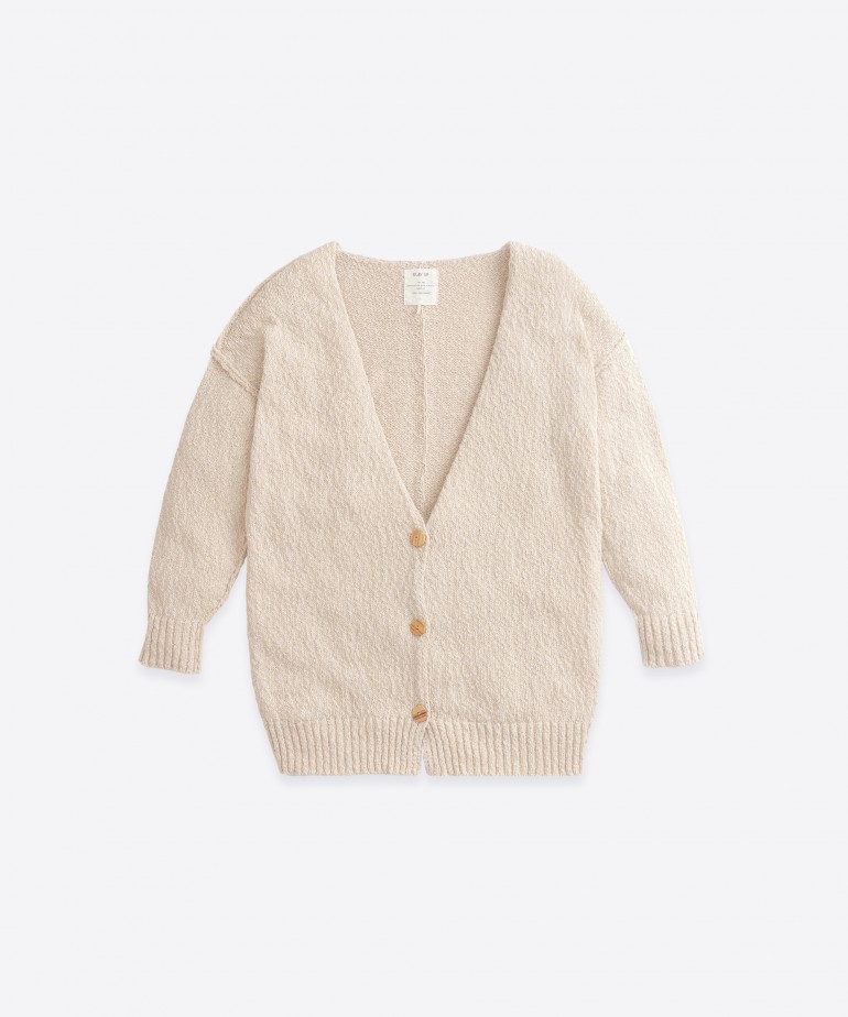 Knitted cardigan with inside-out stitches