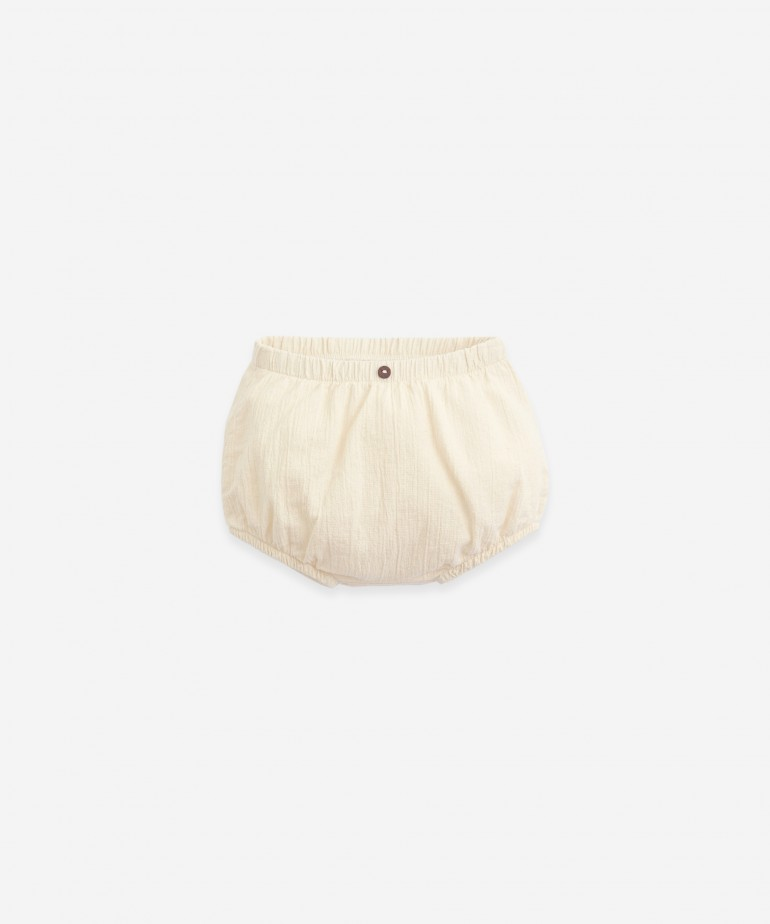Shorts with wooden button