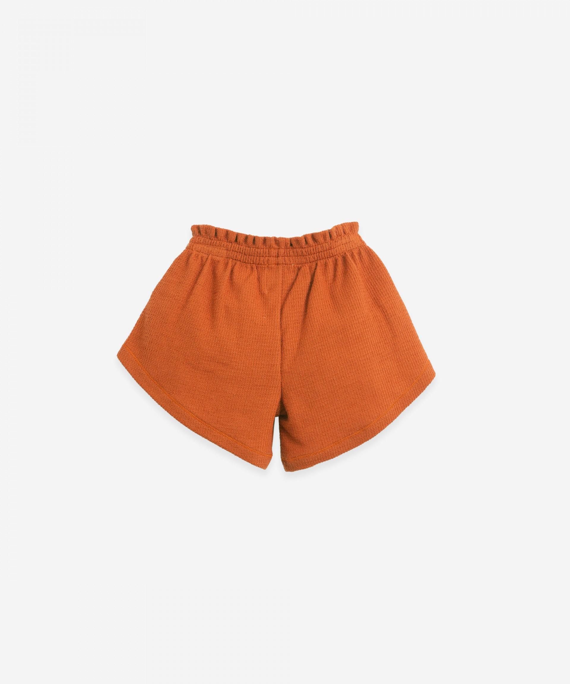 Pantalón corto con lazo decorativo | Botany