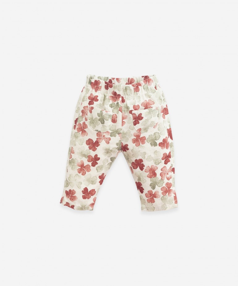 Linen trousers with clover print