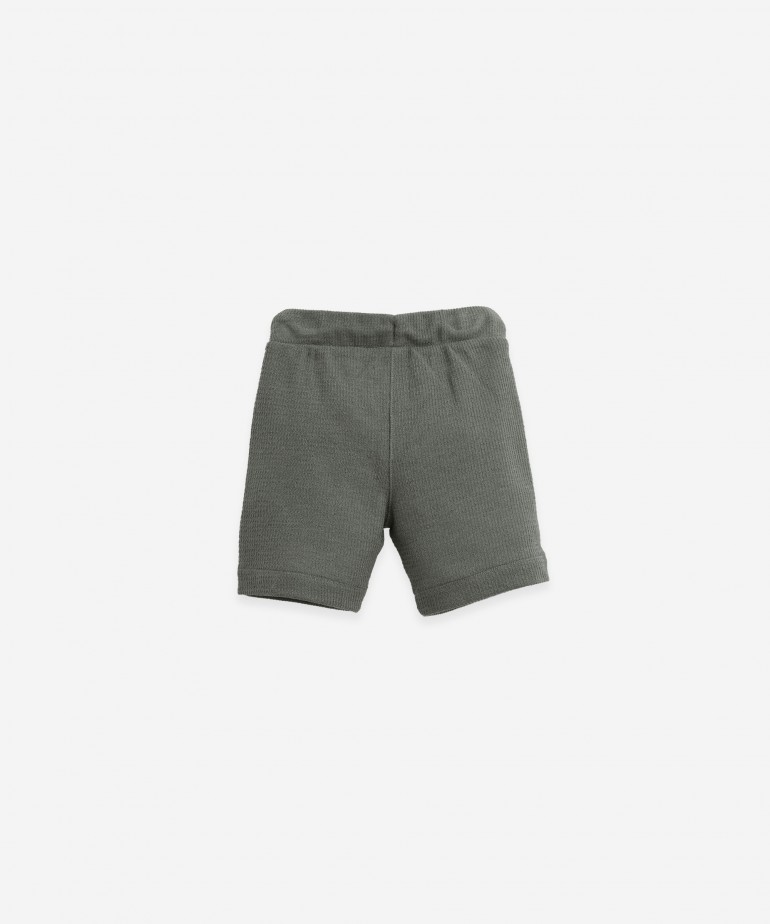 Shorts with adjustable cord