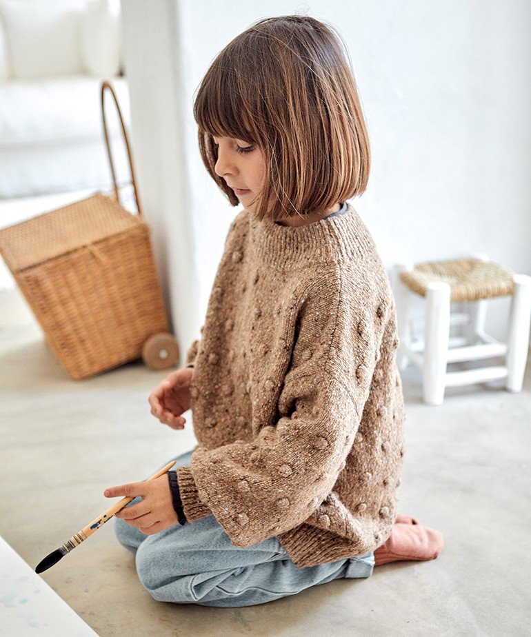 Knitted jersey with high neck