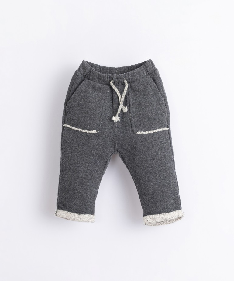 Cotton trousers with hems