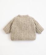 Golfino lavorato a maglia con fibre riciclate | Illustration