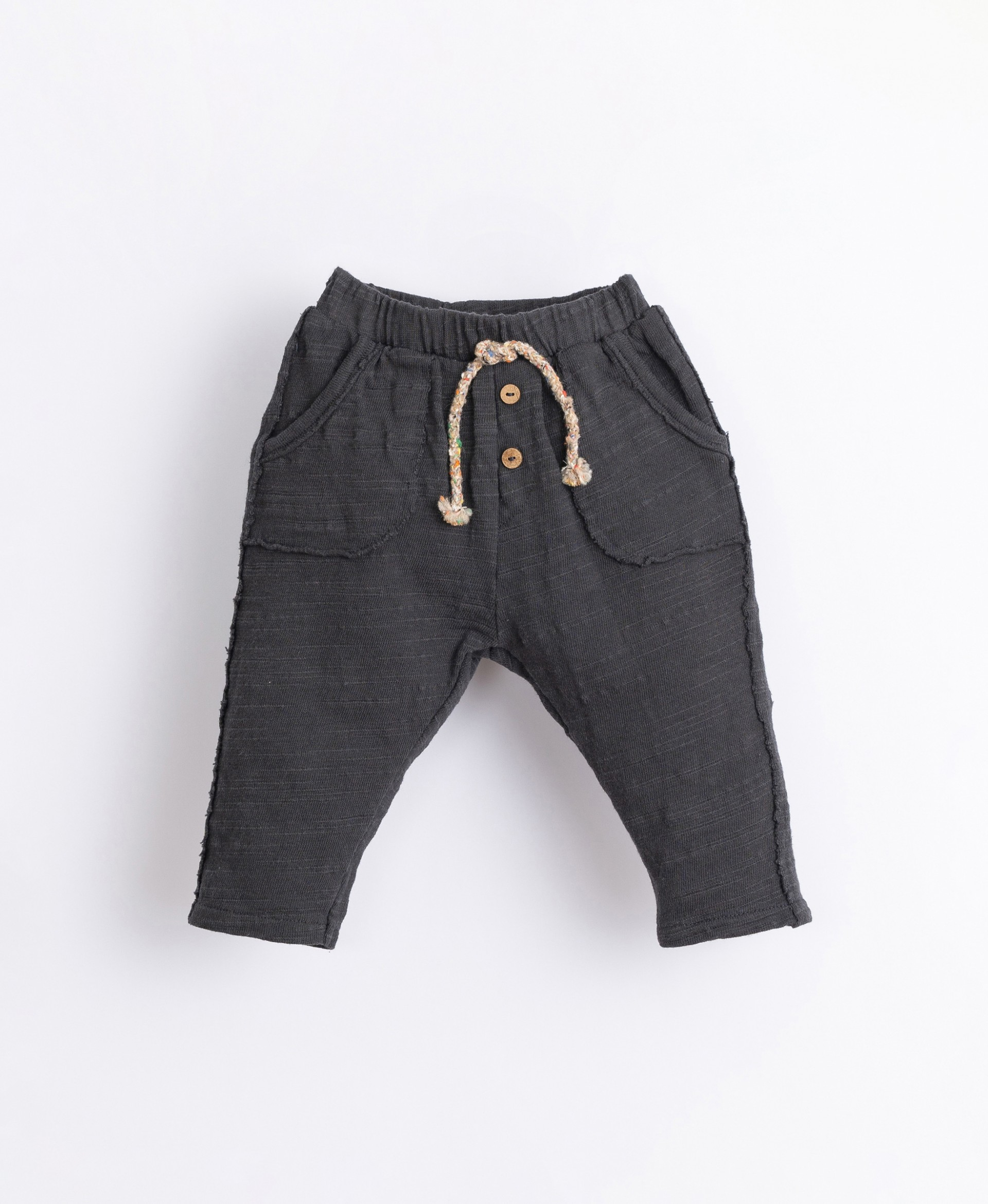 Trousers with decorative buttons | Illustration