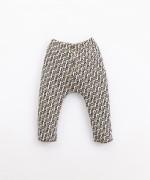 Pantaloni in cotone con bottoni decorativi | Illustration