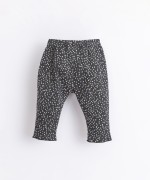 Printed trousers with decorative buttons | Illustration