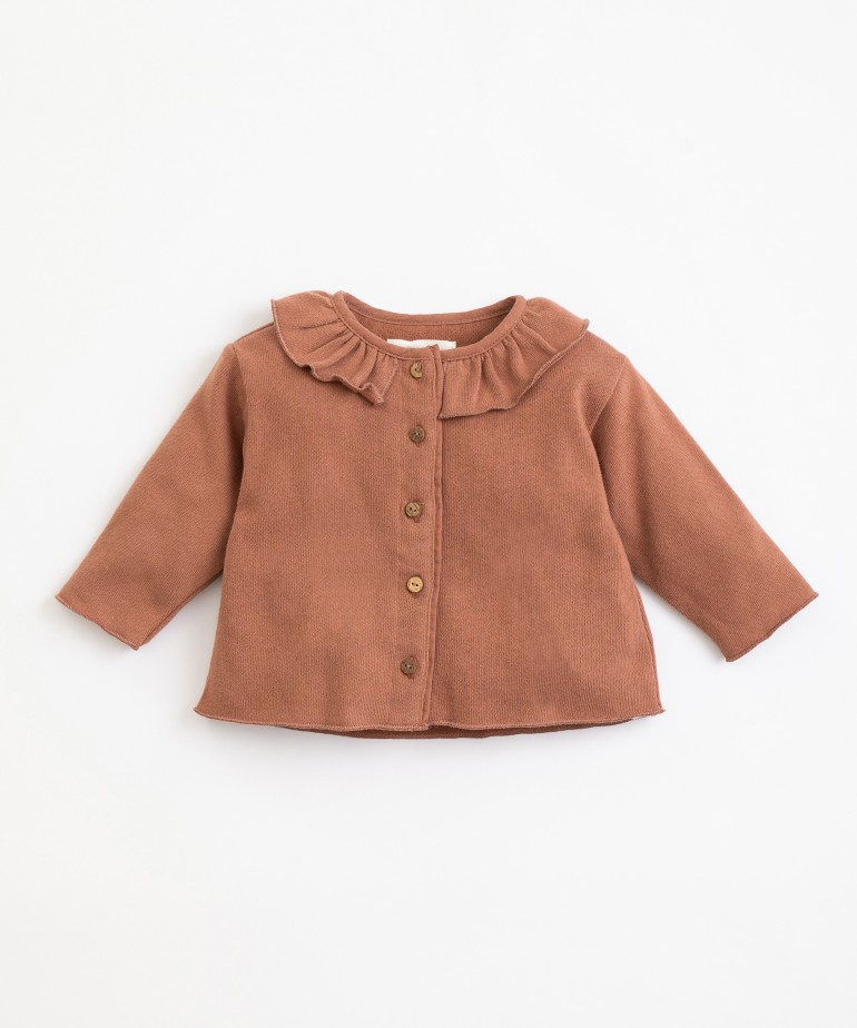 Jacket with frill at the neck
