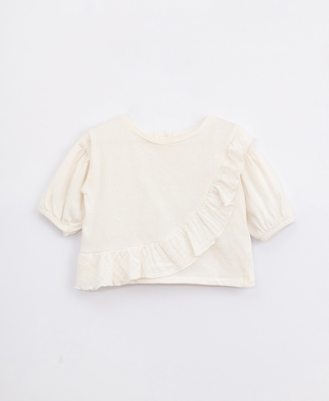 Camiseta de algodón con volante | Illustration