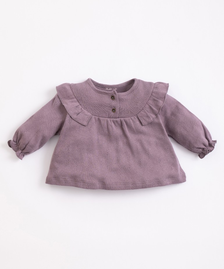 ajour tunic with frill on the shoulders