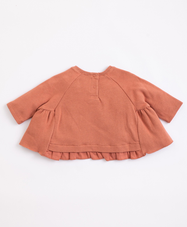 Camisola em algodão orgânico com abertura   Illustration