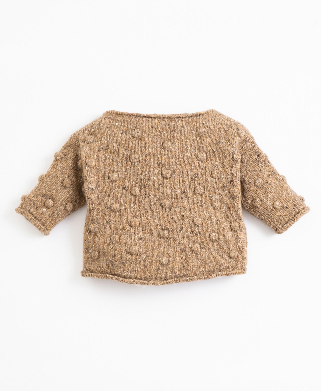 Jersey tricotado con cuello de barco| Illustration