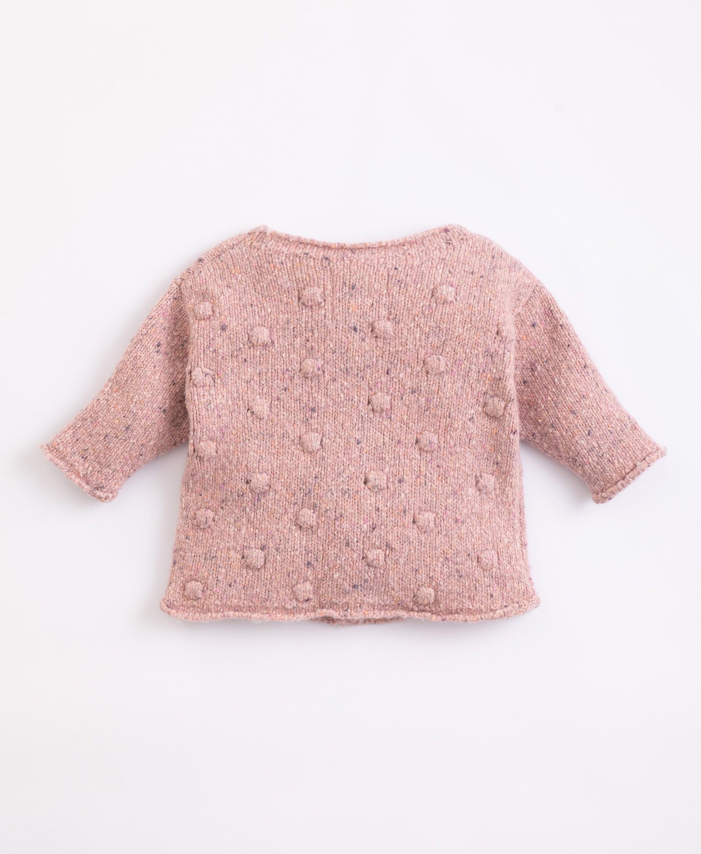 Casaco tricot com fibras recicladas | Illustration