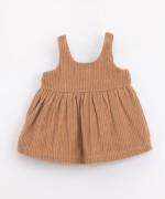 Corduroy dress in organic cotton| Illustration
