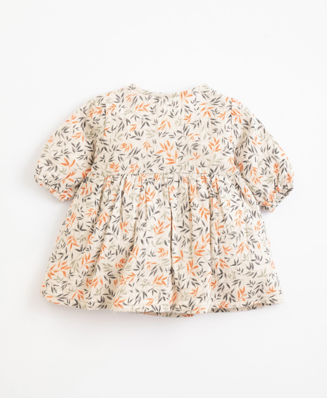 Vestido de tecido com estampado | Illustration