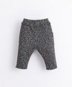 Pantalón de algodón orgánico con volante | Illustration