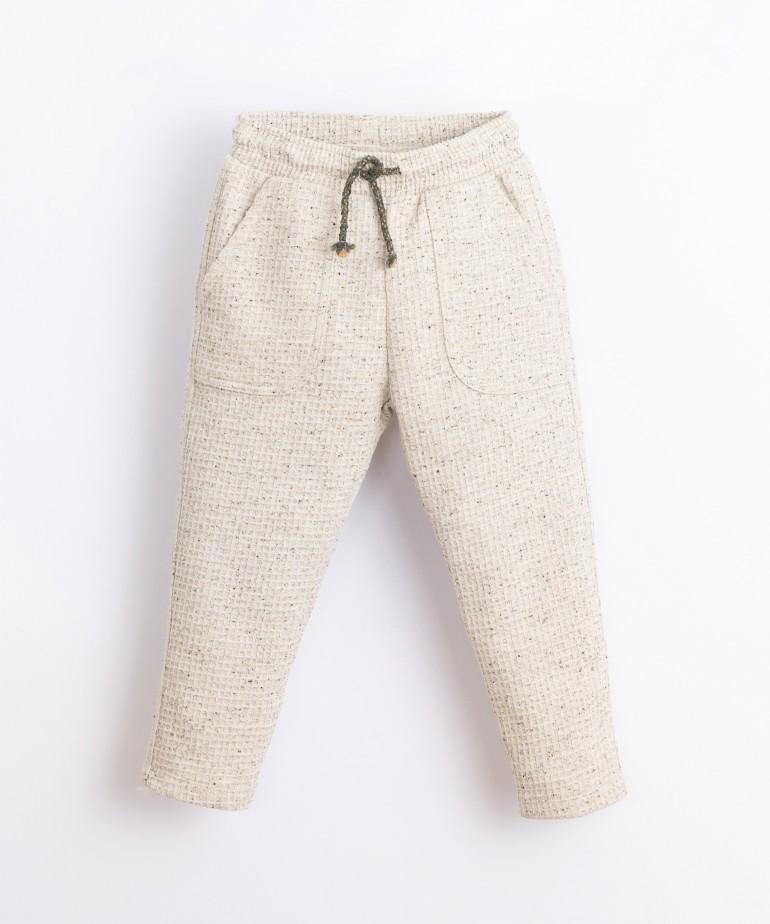 Pantalón reversible con cordón ajustable