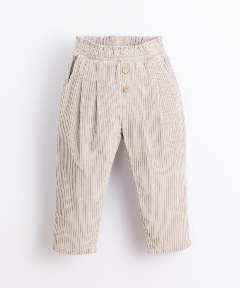 Pantaloni in bombasina con bottoni di decorazione