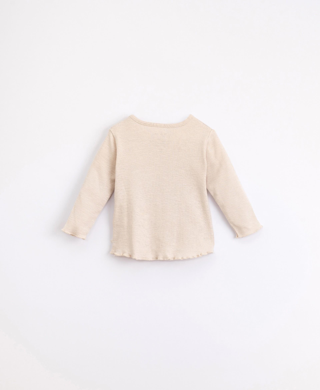 T-shirt em algodão orgânico com abertura no ombro | Illustration