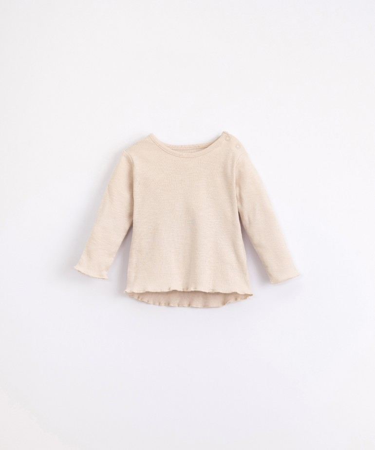 Camiseta de algodón orgánico com corchetes
