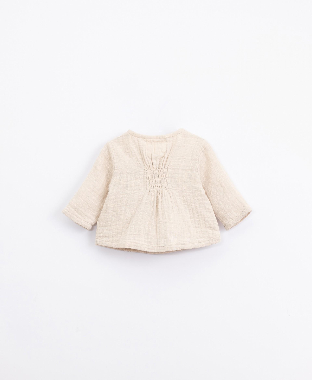 Jersey de algodón con botones de coco | Illustration