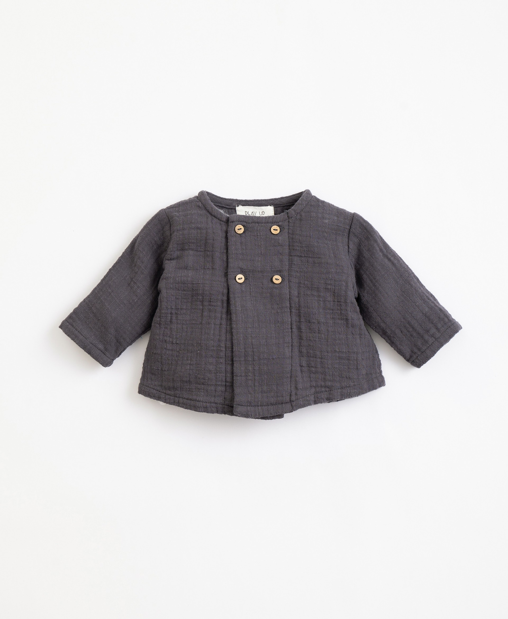 Cotton jersey with coconut buttons| Illustration