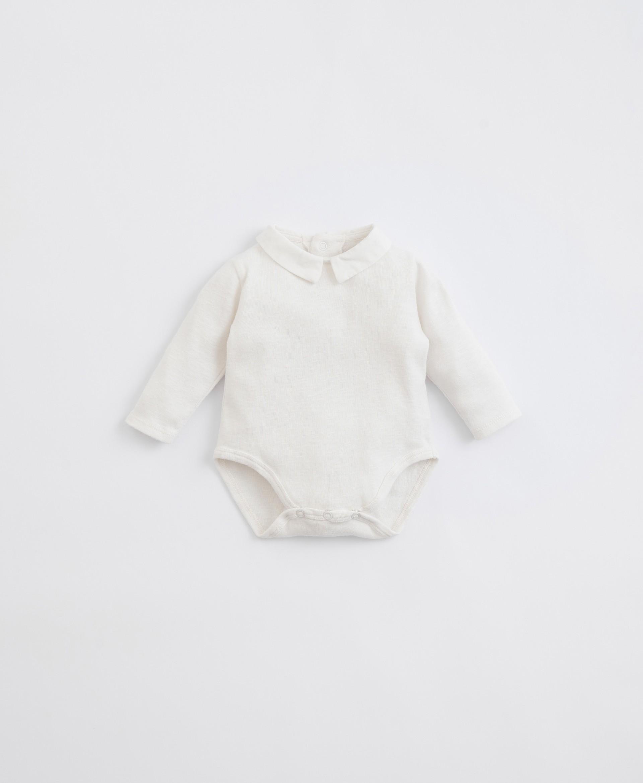 Body in cotone organico con collo in tessuto | Illustration