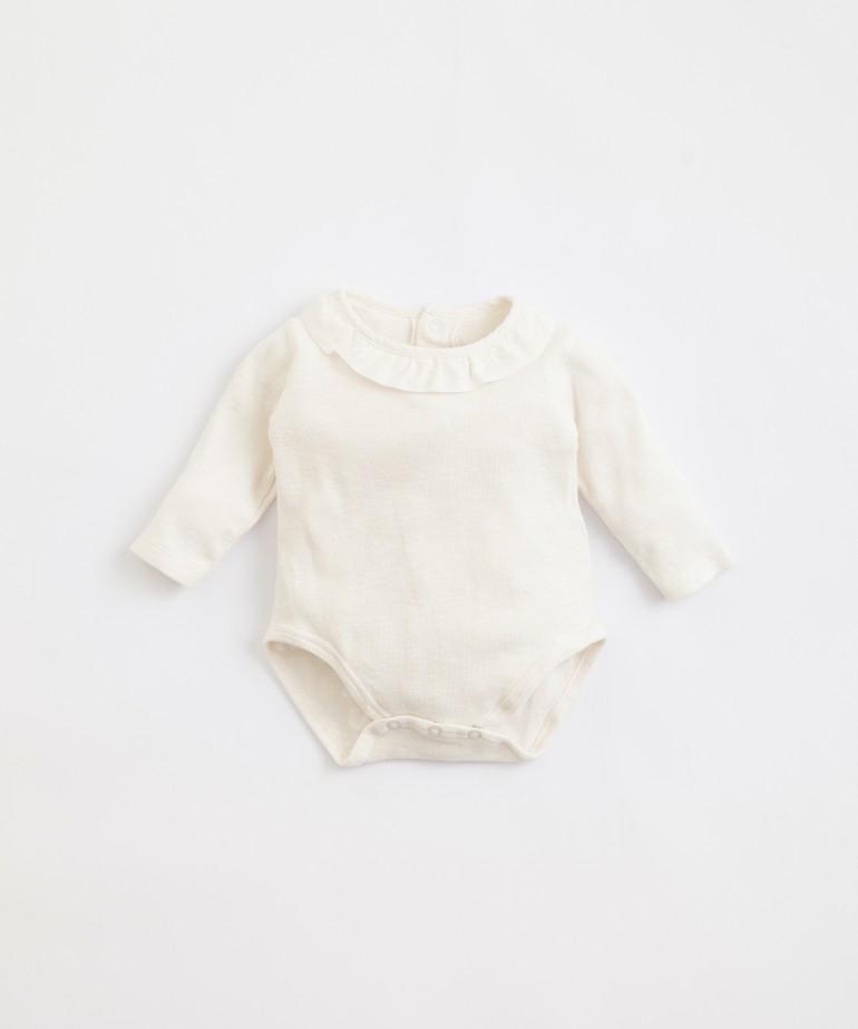 Body de algodón orgánico con volante de tela